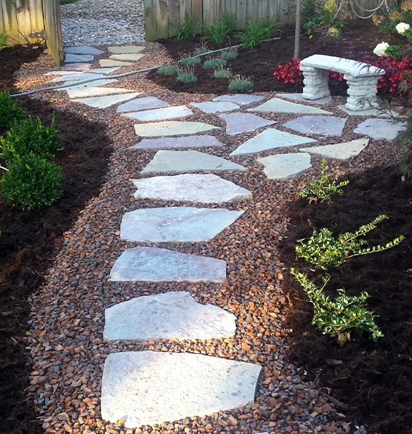 landscape design showing stepping stones set in gravel surrounded by greenery