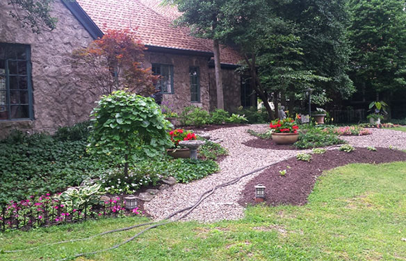 Landscaping service install with mulch gravel walks and greenery