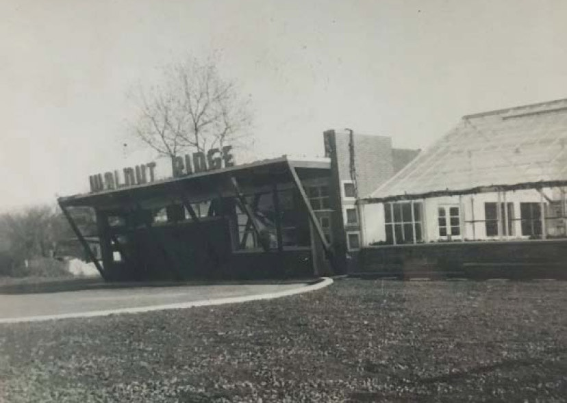 Historic photo of building with Walnut Ridge sign. The beginning of the best jeffersonville Landscaper